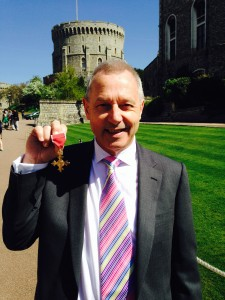 Business West director Clive Wray presented with his OBE by the Queen